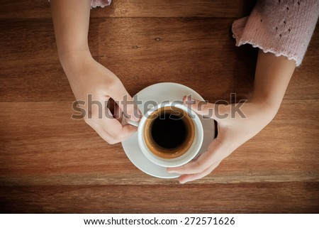young woman holding hot cup of coffee ,Vintage effect