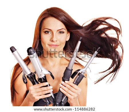 Young woman holding iron curling hair. Isolated. - stock photo