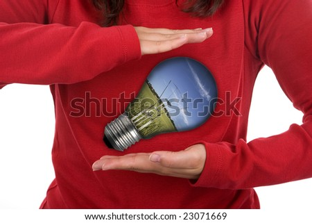 young woman holding light bulb - environmental concept - stock photo