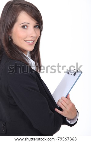 Young woman holding notepad - stock photo