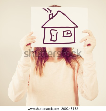 young woman holding picture with house. Photo with instagram style filters - stock photo