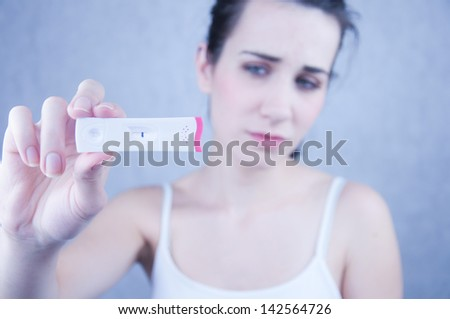 Young Woman Holding Pregnancy Test - stock photo