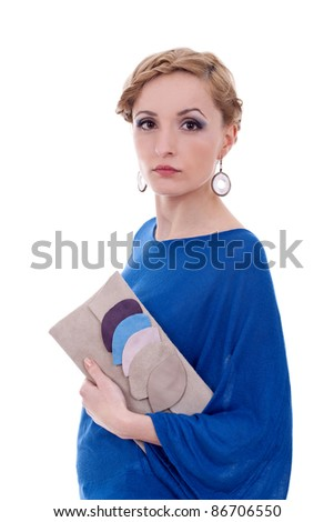 young woman holding purse against white background - stock photo