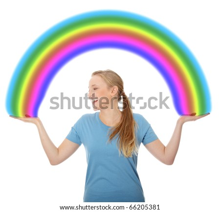 Young woman holding rainbow, isolated on white - stock photo