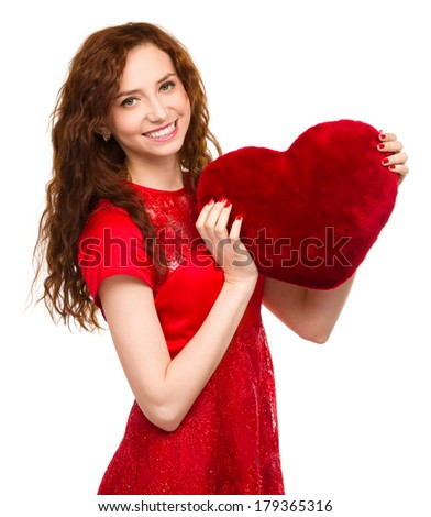 Young woman holding red heart, Valentine day concept, isolated over white - stock photo