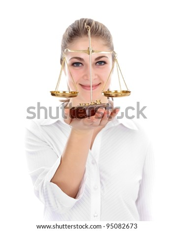 Young woman holding scale of justice - stock photo