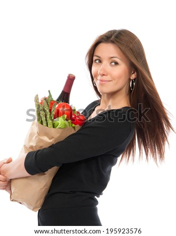 Young woman holding shopping bag with groceries vegetables and fruits isolated on white background. Healthy eating concept - stock photo