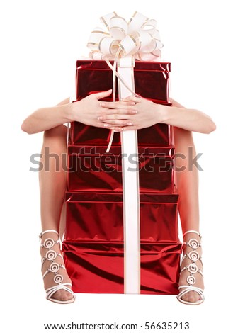 Young woman holding stack gift box. Isolated. - stock photo
