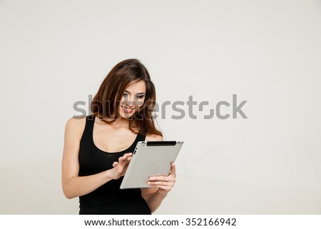 young woman holding tablet pc