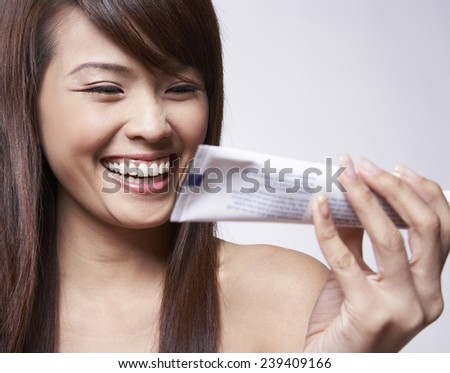 Young Woman Holding Toothpaste