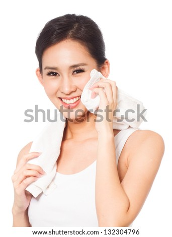 Young woman holding towel and smiling