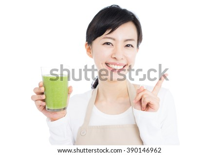 young woman holding vegetable smoothie, isolated on white background - stock photo