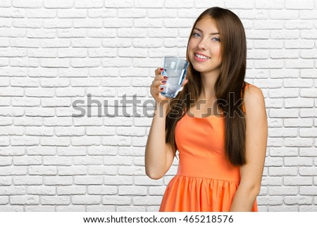 Young woman holding water glass