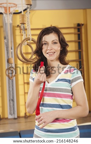 Young woman holding whistle - stock photo