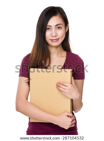 Young woman holding with her homework - stock photo