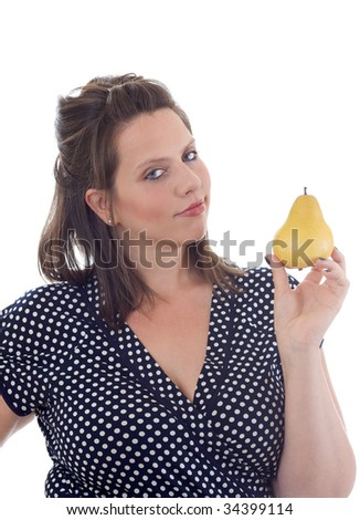 Young woman holds a pear on display in her hand; isolated on a white background. - stock photo