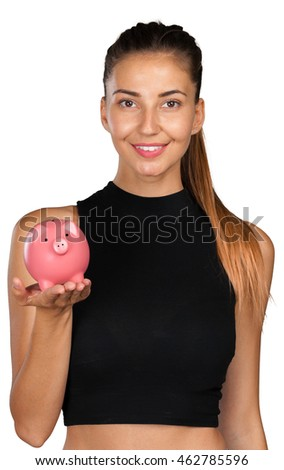 Young woman holds a piggy bank