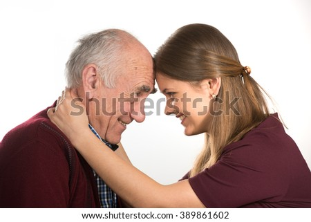young woman hugging old senior man - stock photo