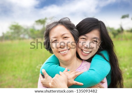 young woman hugging with her mother - stock photo