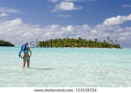 Young woman in a bikini in a tropical lagoon in Fiji in the South Pacific. - stock photo
