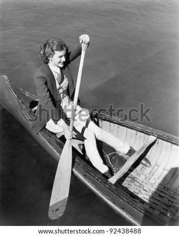 Young woman in a canoe rowing