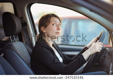 Young woman in a car