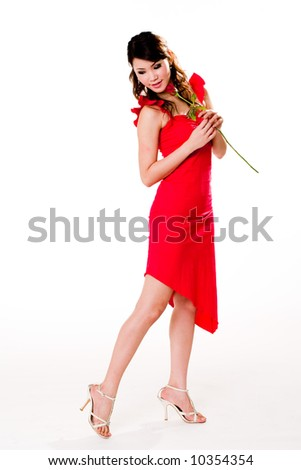 young woman in a dance like pose wit a rose in her hand
