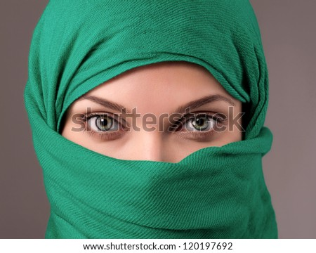 Young woman in a green hijab