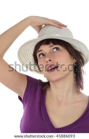 Young woman  in a hat looks upwards - stock photo