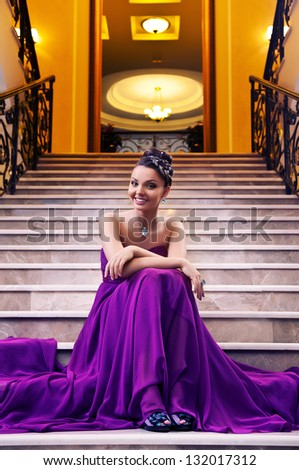 young woman in a long dress - stock photo