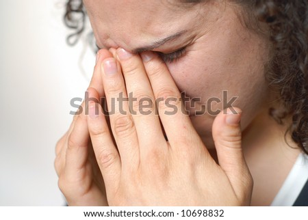 Young woman in a lot of pain - stock photo