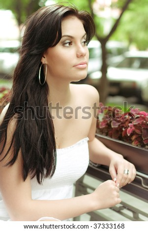 Young woman in a park - stock photo