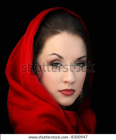 Young woman in a red scarf on black - stock photo