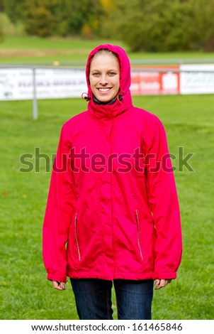 Young woman in a stadium - stock photo