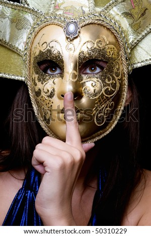 Young woman in a Venetian mask. Isolated - stock photo