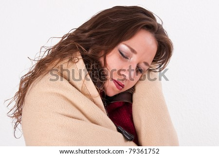 Young woman in a warm blanket