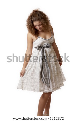 young woman in a white summer dress isolated on white