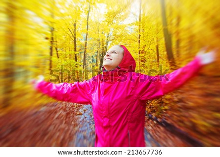Young woman in autumn forest - stock photo