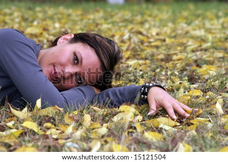 Young woman in autumn par