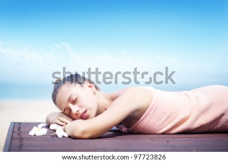 Young woman in beach spa - stock photo