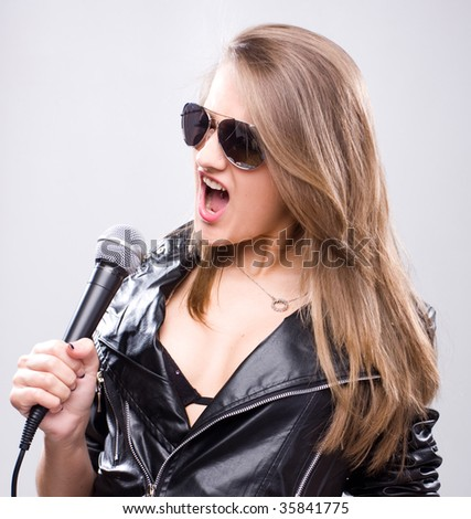 young woman in black leather jacket with microphone