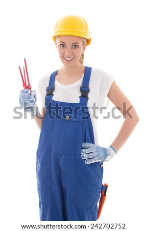 young woman in blue builder uniform with screwdrivers isolated on white background - stock photo