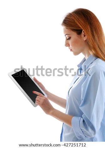 Young woman in blue shirt using tablet, isolated on white