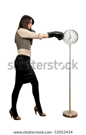 Young woman in boxing gloves beating the clock isolated on white - stock photo