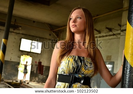 young woman in broken old factory - stock photo