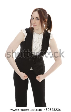Young woman in business suit flexing her arm muscle against a white background