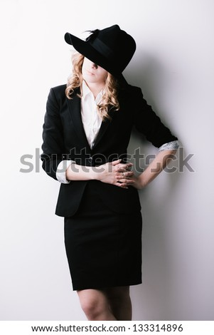 Young woman in  business suit in hat
