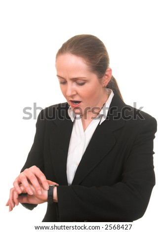 Young woman in business suit looking at her watch upset as she is late isolated on white - stock photo