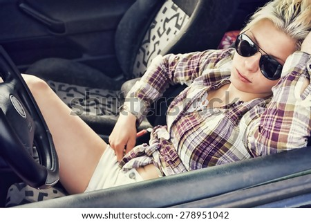 Young woman in car - stock photo