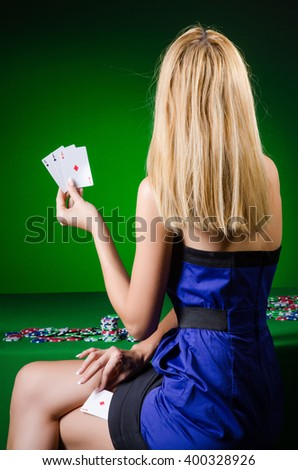Young woman in casino gambling concept - stock photo